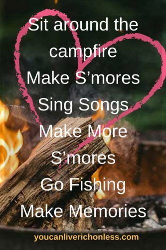"""campfire in the background large pink heart with the text """"Sit around the campfire Make S'mores Sing Songs Make More S'mores Go Fishing Make Memories"""""""