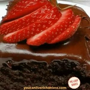 slice of chocolate cake with sliced strawberries on top