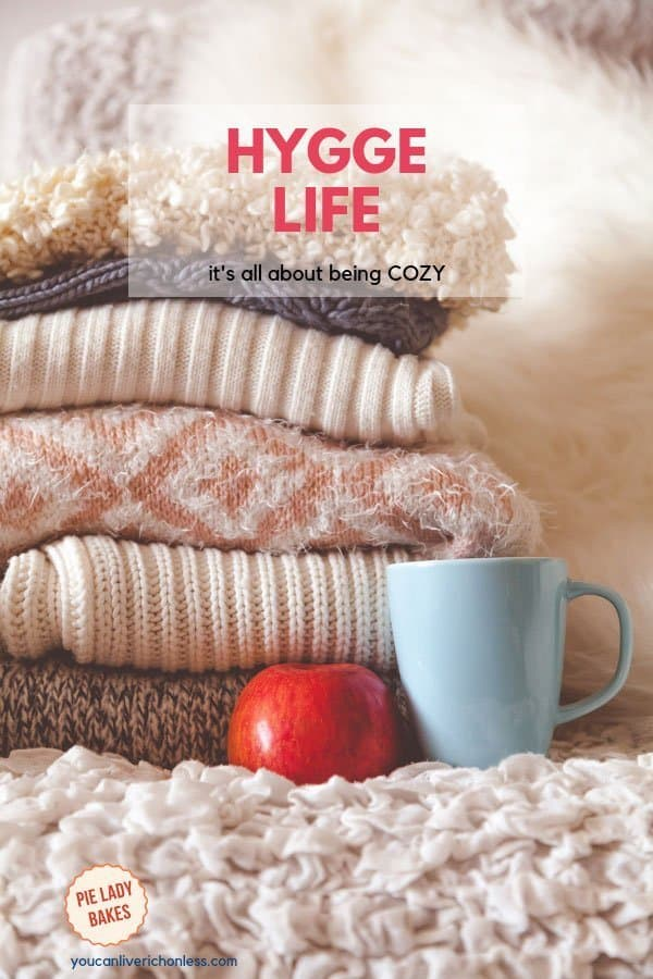 What is all the hype about Hygge anyway? Click through to see how to bring this Danish concept of happiness into your home with hygge home decor, knitted blankets, soft candles, and experience the serenity and joy. #hyggelife #hygge #candles #hyggedecor