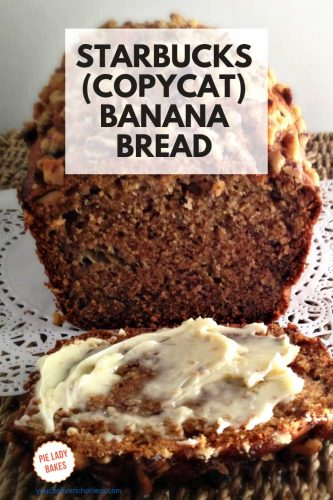 starbucks copycat banana bread pin image with whole loaf one slice buttered in the foreground on white paper doily