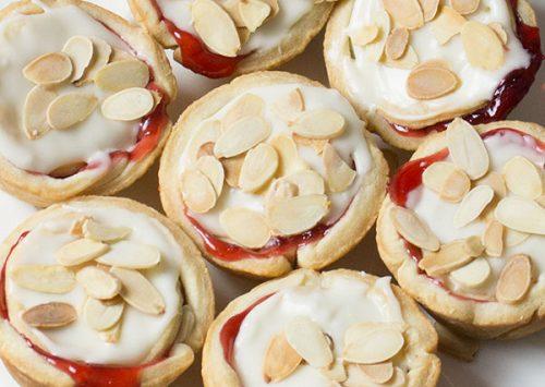 plate of cranberry cherry tarts with almond glaze