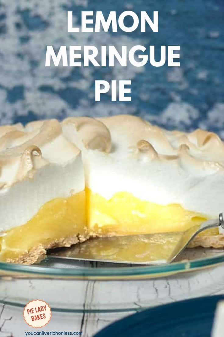 lemon meringue pie with piece removed and pie server