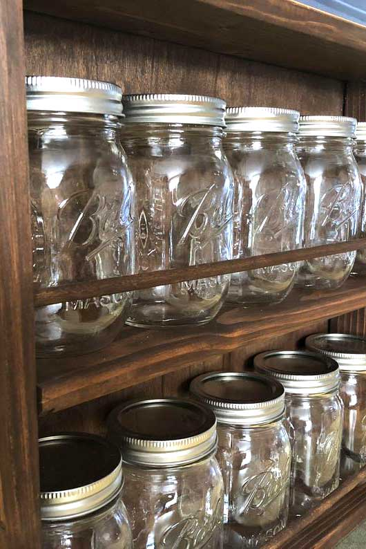 spice rack dark brown wood with Ball mason jars for spices