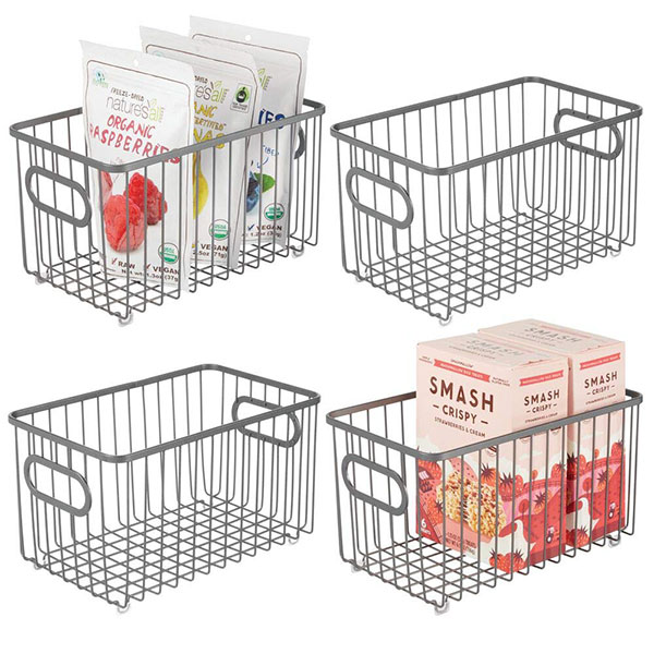 four pantry storage wire baskets with food products in two of the baskets