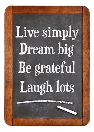 small chalkboard reads live simply dream big be grateful laugh lots with brown wooden frame