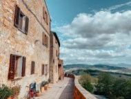 beautiful blue cloudy sky with views from the top in pienza