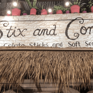 stix and cones store front with potted plants above in el nido philippines palawan
