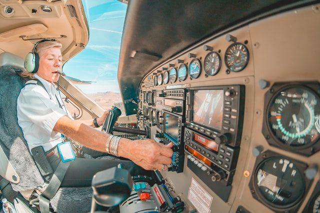 Female pilot in cockpit travel required jobs