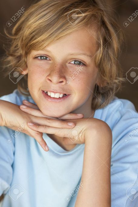 22011374-Young-happy-smiling-blond-boy-child-aged-about-12-or-early-teenager--Stock-Photo