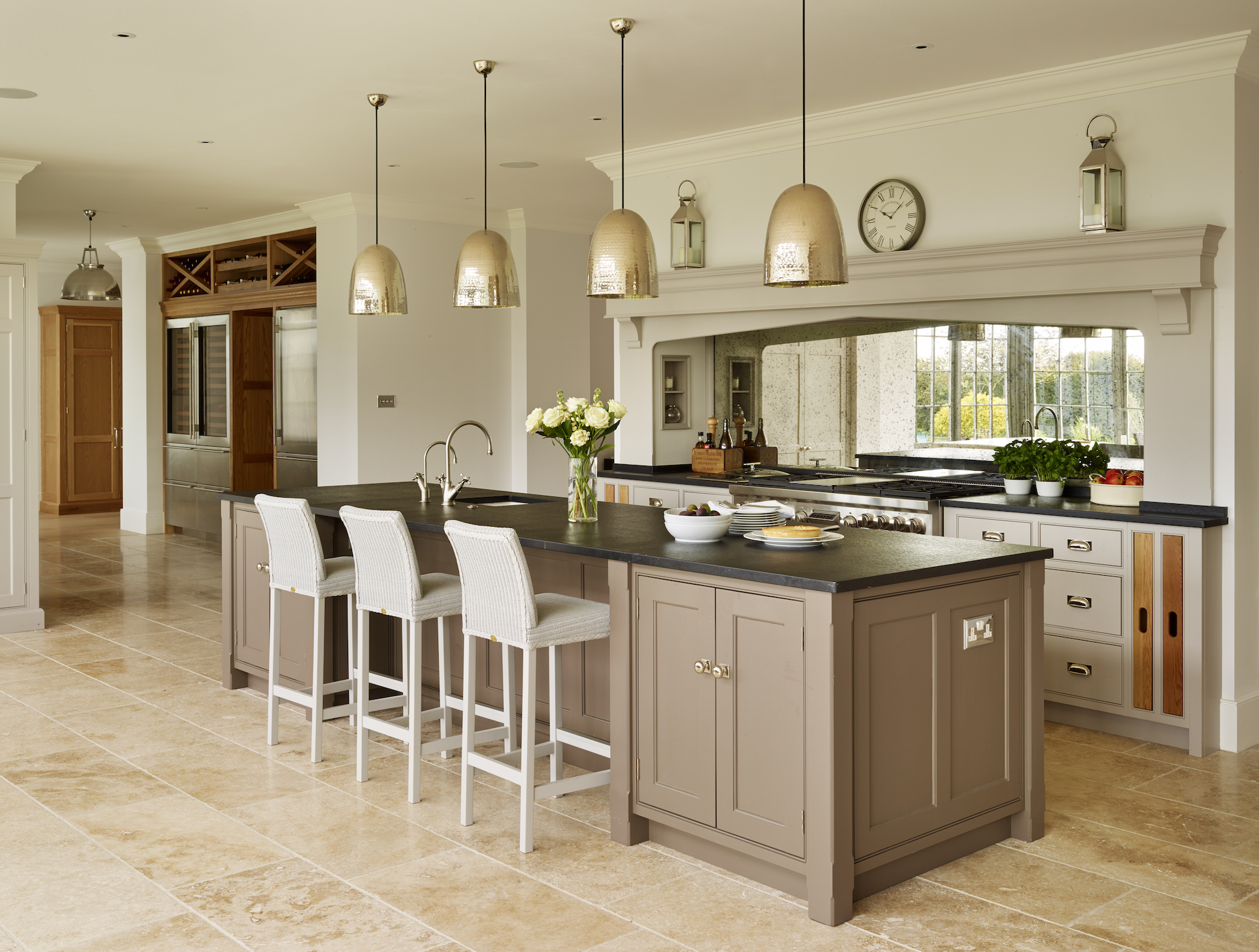 The Island Modular Kitchen Design Looks Perfect With The Four Lamps Hanged  Over The Dining Portion.The Light Brown Color In The Kitchen Looks So  Beautiful ...