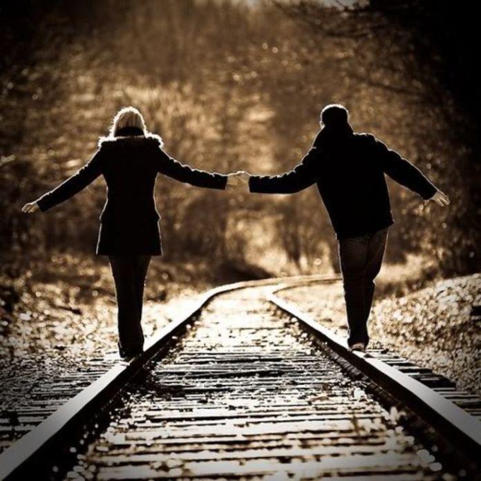 couple photo on train track