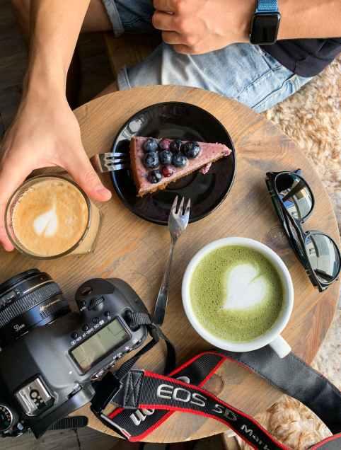 white ceramic mugs beside black sunglasses