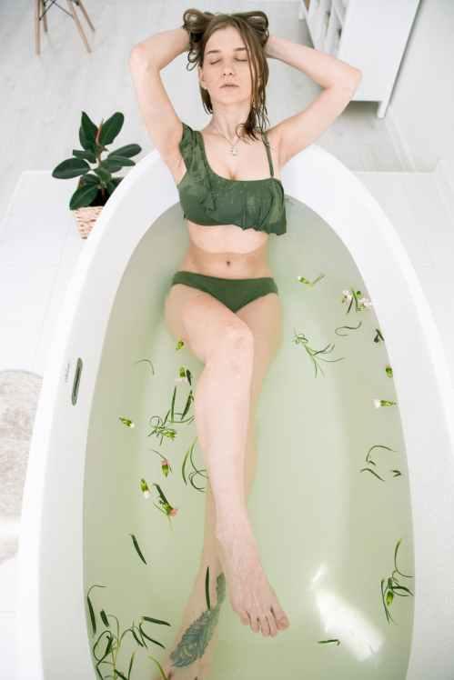 photo of woman on bathtub