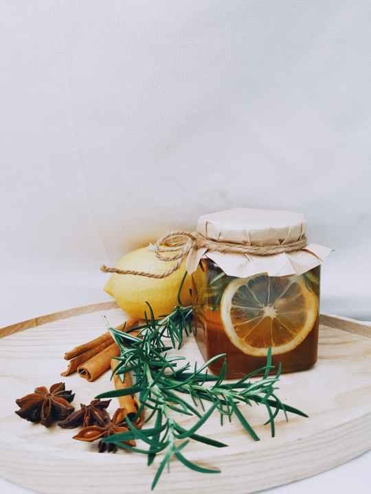 photo of jar near cinnamon sticks