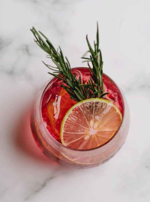 glass of refreshing drink with grapefruit and rosemary
