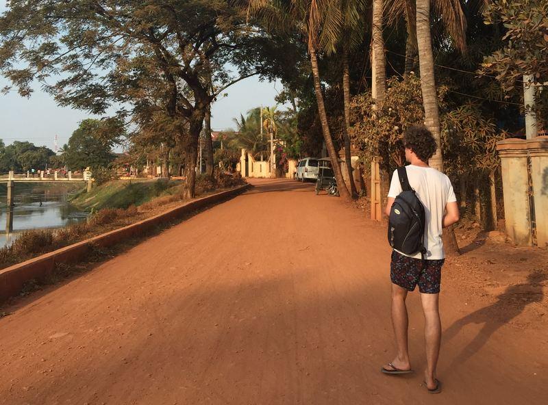 Man walking on road in Cambodia