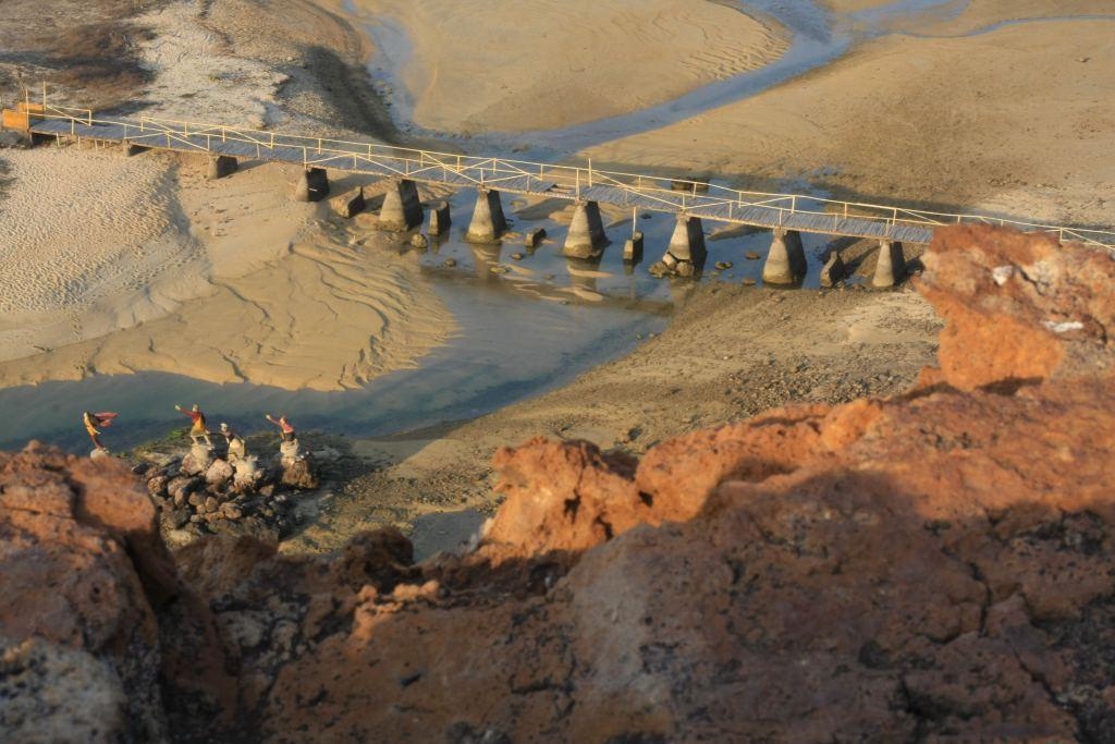 Bridge crossing shallow stream