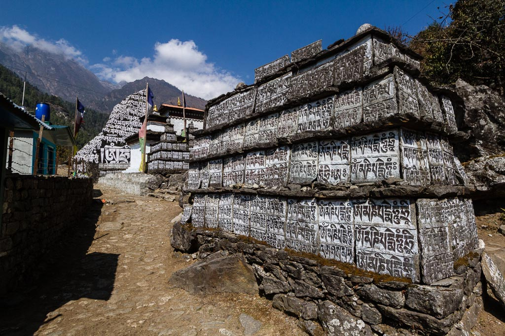 A mani wall inscribed with prayers in Tibetan