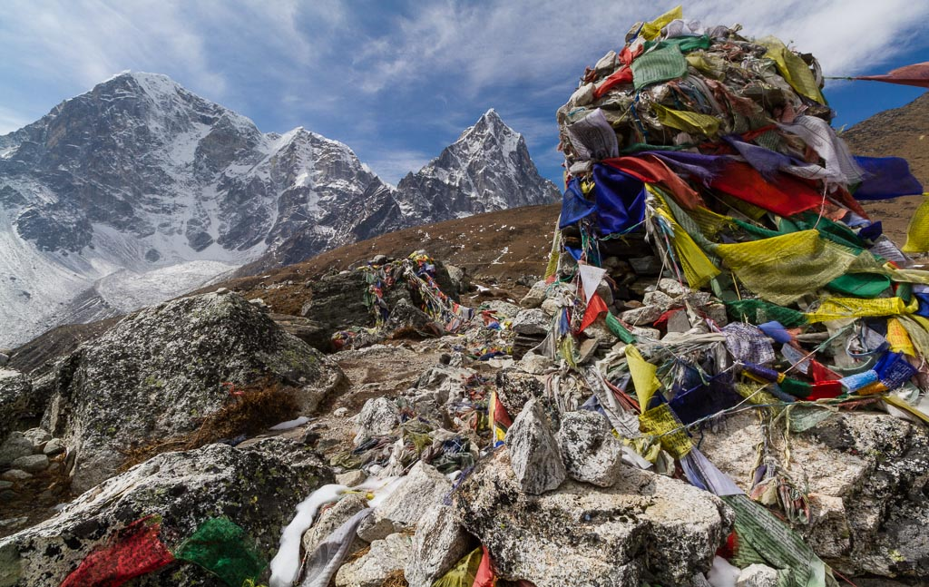 A memorial wrapped in prayer flags