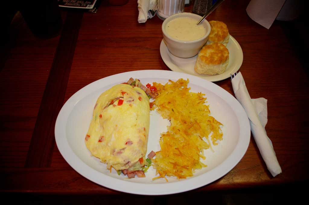Youngblood's  Cafe Texas Home Cookin' – Western Omelette With Hash Browns and Biscuits and Gravy
