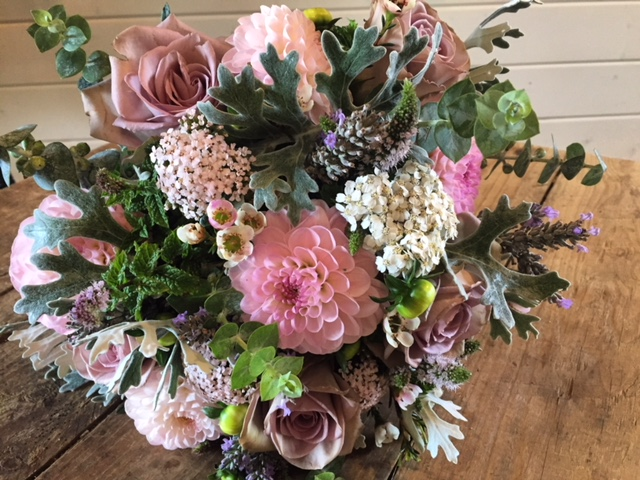 Softer pink dahlias, mixed with roses, herbs and white achillea.