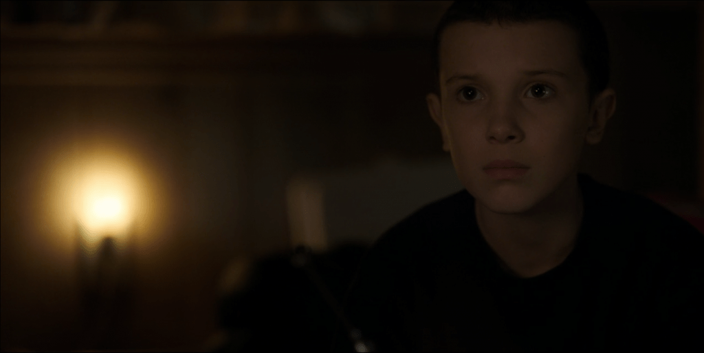 Eleven looking into the camera, hurt.