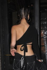 New York, NY - Bella Hadid displays her tiny waist for a night on the town with friends in New York. The brunette model is wearing lace up pants with an asymmetrical crop top paired with heels. AKM-GSI December 16, 2016 To License These Photos, Please Contact : Maria Buda (917) 242-1505 mbuda@akmgsi.com sales@akmgsi.com or Mark Satter (317) 691-9592 msatter@akmgsi.com sales@akmgsi.com www.akmgsi.com
