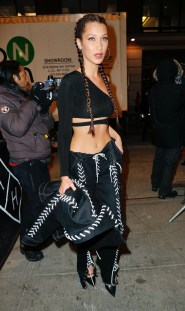 Bella Hadid wears a daring 'stichy' outfit bearing her shoulder and midriff when out in -6 degree Celsius weather in New York Pictured: Bella Hadid Ref: SPL1412130 161216 Picture by: Jackson Lee /  Splash News Splash News and Pictures Los Angeles: 310-821-2666 New York: 212-619-2666 London: 870-934-2666 photodesk@splashnews.com