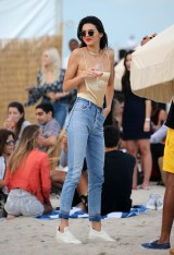 December 4, 2016: Kendall Jenner wears a revealing strappy top and jeans as she enjoys a glass of wine on the beach in Miami. Mandatory Credit: INSTARimages Ref: infusmi-20/21 -Kendall Jenner -INSTAR_Kendall_Jenner_v_116838.JPG Kendall Jenner Mandatory Credit: INSTARimages.com Ref: infusmi-20/21 INSTAR_Kendall_Jenner_v_116838.JPG Editorial - Rights Managed Image - Please contact www.www.INSTARimages.com for licensing fee INSTARimages New York, NY 20W 22nd Street, suite 816 212-4140-207 photodesk@instarimages.com sales@instarimages.com INSTARimages reserves the right to pursue unauthorized users of this image. If you violate our intellectual property you may be liable for actual damages, loss of income, and profits you derive from the use of this image, and where appropriate, the cost of collection and/or statutory damages. Image may not be published in any way that is or might be deemed defamatory, libelous, pornographic, or obscene. Please consult our sales department for any clarification or question you may have.
