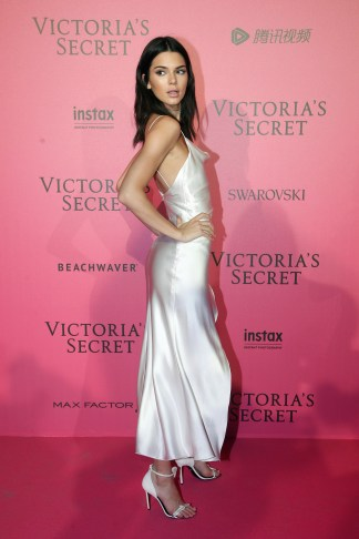 Model Kendall Jenner poses during the after party photocall after the Victoria's Secret fashion show Wednesday, Nov. 30, 2016 in Paris. The Victoria's Secret fashion show took place in Paris with performances by Lady Gaga and Bruno Mars. (AP Photo/Thibault Camus)