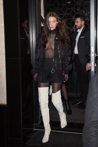 North America Rights Only - Paris, France - 01/20/2017 - Bella Hadid leaving Kinu Japanese restaurant and arriving Le Magnifique nightclub during menswear Paris fashion week in Paris, France. -PICTURED: Bella Hadid -PHOTO by: INSTARimages.com -Instar_Hadid_Jenner_Smalls_in_Paris_1141500002218.JPG Editorial Rights Managed Image - Please contact www.INSTARimages.com for licensing fee and rights: North America Inquiries: email sales@instarimages.com or call 212.414.0207 - UK Inquiries: email ben@instarimages.com or call + 7715 698 715 - Australia Inquiries: email sarah@instarimages.com.au Êor call +02 9660 0500 Ð for any other Country, please email sales@instarimages.com. ÊImage or video may not be published in any way that is or might be deemed defamatory, libelous, pornographic, or obscene / Please consult our sales department for any clarification or question you may have - http://www.INSTARimages.com reserves the right to pursue unauthorized users of this image or video. If you are in violation of our intellectual property you may be liable for actual damages, loss of income, and profits you derive from the use of this image or video, and where appropriate, the cost of collection and/or statutory damage.