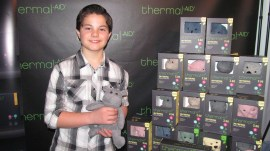 ACTOR ZACH CALLISON STOPS BY THE THERMAL AID BOOTH AT THE WOW GIFT LOUNGE FOR THE 85TH ACADEMY AWARDS