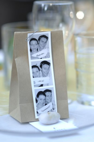 wedding favor for backyard wedding featuring paper bag with flower bulb and photostrip