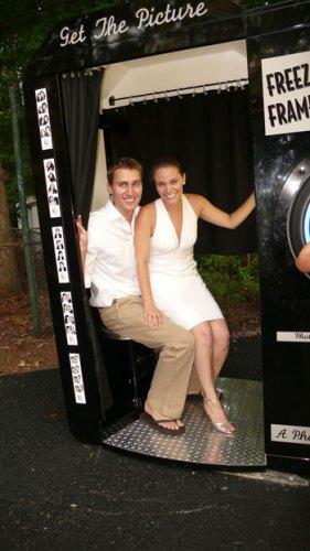 bride and groom in rented photobooth for DIY backyard wedding