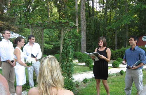 sister and brother of the groom and bridge doing reading during backyard wedding