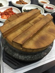 """Dolsot Rice """"돌솥밥""""- rice cooked in a hot stone bowl. The stone allows the inside material to stay hot for a long time."""
