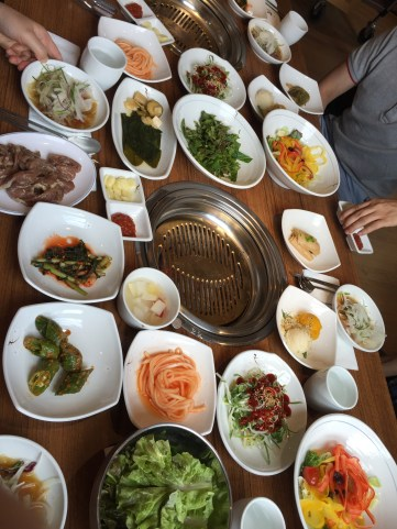 A Korean meal typically comes with a variety of side dishes. These sides are meant to be shared with the whole table. There are a lot more communal aspects of eating as compared to the U.S.