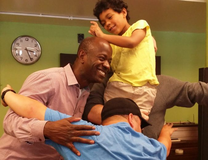 Parents and caregivers try Tableau & Improvisation with their children.