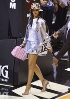 51406030 Singer Rihanna enjoys a beer as she sits court side at the Miami Heat vs. Brooklyn Nets NBA Playoff basketball game in Miami, Florida on May 8, 2014. FameFlynet, Inc - Beverly Hills, CA, USA - +1 (818) 307-4813