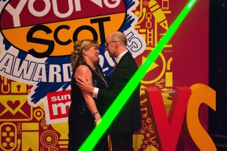 FOR SUNDAY MAIL Young Scot 2014 winner: Deputy First Minister John Swinney presents award to Alison Barr on behalf of Jak trueman. Young Scot Awards 2015, Usher Hall, Edinburgh.. FEE PAYABLE FOR ALL INTERNET USE All money payable:- Mark Anderson Flat 2/2 Glasgow G41 3HG