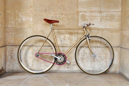 Vintage fixed gear bicycle with a pink chain