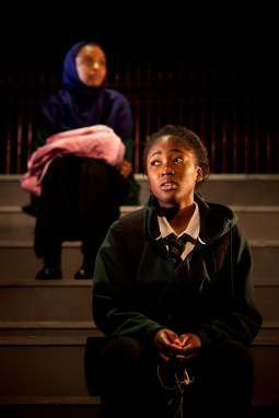Cutting It.... A new play by Charlene James tackling the urgent issue of FGM in Britain at the Young Vic Theatre, London. Director- Gbolahan Obisesan Actors... Adelayo Adedayo (school uniform with Tie) plays Muna and Tsion Habte plays Iqra. Teenagers Muna and Iqra get the same bus to school but they've never really spoken. Muna wears Topshop and sits on the top deck gossiping about Nicki Minaj's latest beef, while Iqra sits alone downstairs in her charity shop hand-me-downs. They were both born in Somalia but come from different worlds. But as they get closer, they realise that their families share a painful secret. Tackling the urgent issue of FGM in Britain, Charlene James' devastating new play reveals the price some girls pay to become a woman. photograph by David Sandison www.dsandison.com +44 7710 576 445 +44 208 979 6745