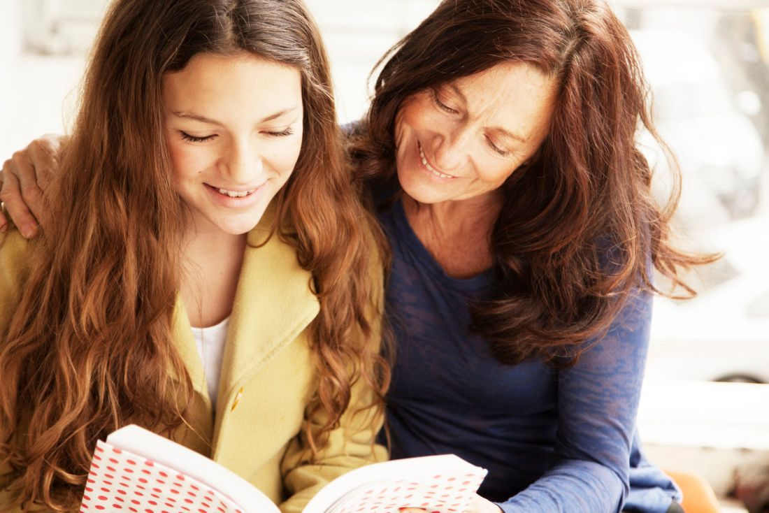 41838138 - happy girl with grandmother studying