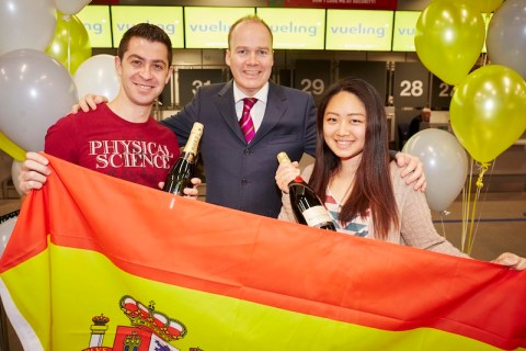 Manchester Airport celebrate the first flight from T3 by Spanish airline Veiling, passenger Fang-Tzu Tsao and her boyfriend Bekir Satlimis from Ardwick in Manchester picked out at check-in and treated to bottles of Champaign WITH Patrick Alexander from the airport (middle)