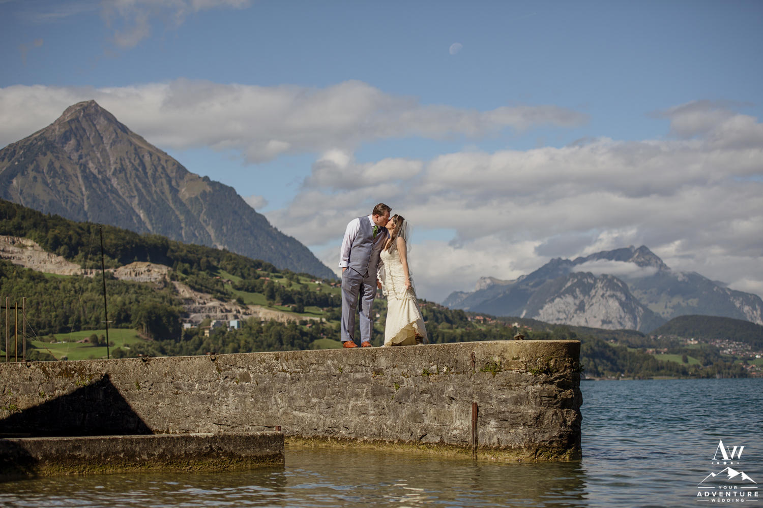 Couple kissing in front of Interlaken Switzerland