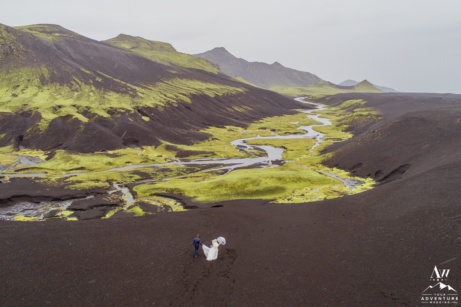 Couple Running during Iceland Adventure Wedding in the Highlands