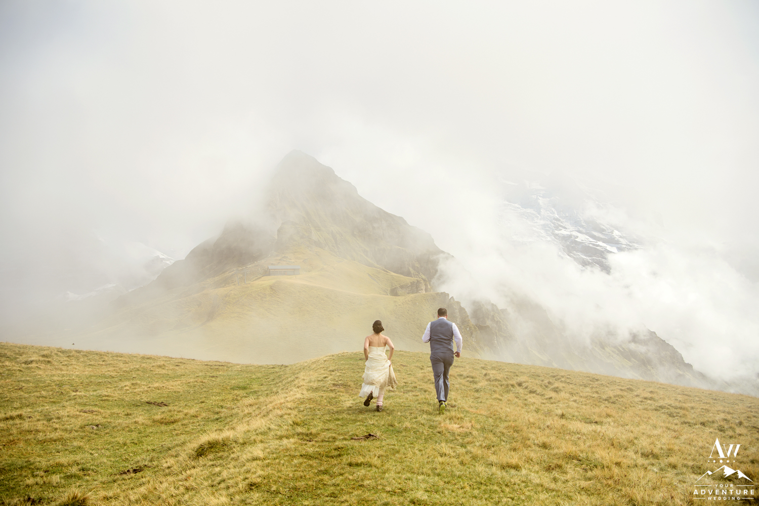 Switzerland Elopement Couple running towards Jungfrau mountain