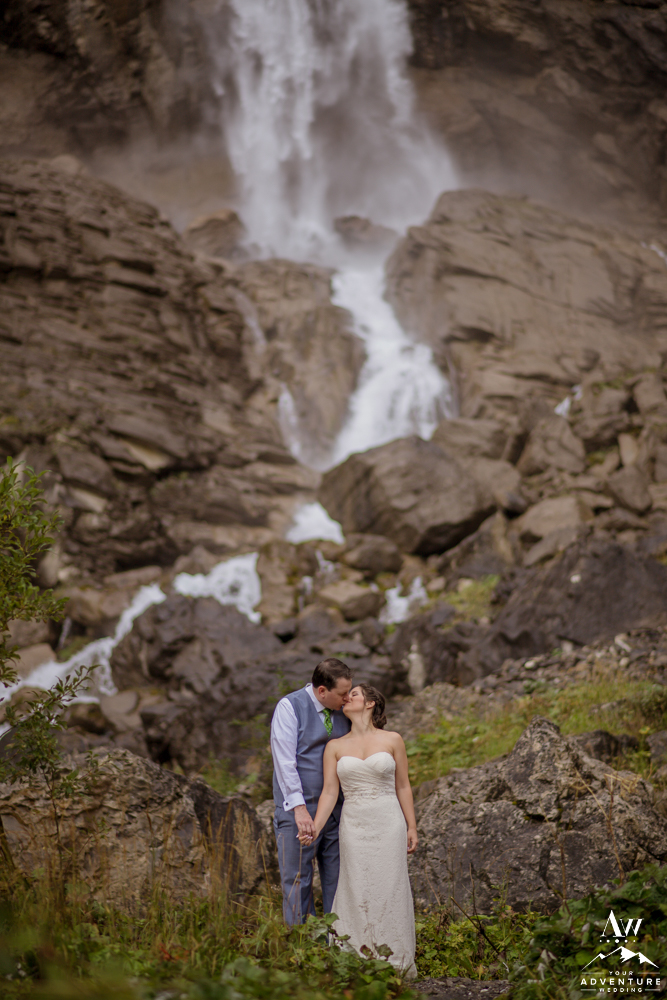 Switzerland Elopement Couple Kissing at Engstligenalp Waterfall