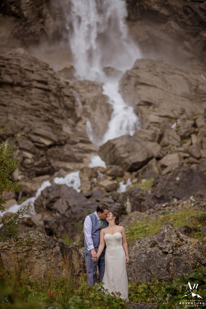 Switzerland Elopement Couple Kissing at Engstligenalp Waterfall