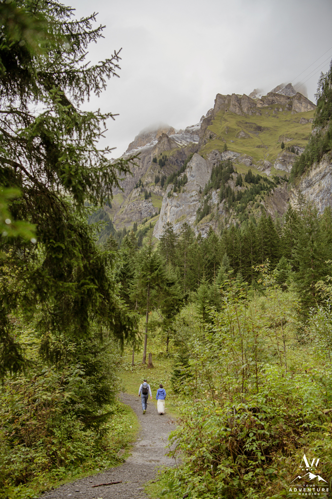 Switzerland Elopement Couple Hiking in the Woods